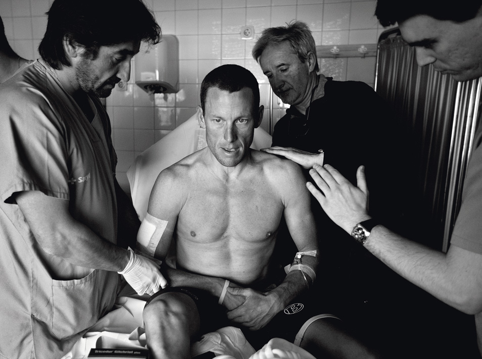 Armstrong is examined in a hospital after he broke his collarbone in a crash during Castilla Y Leon cycling race in Baltanas Spain, March 23, 2009.