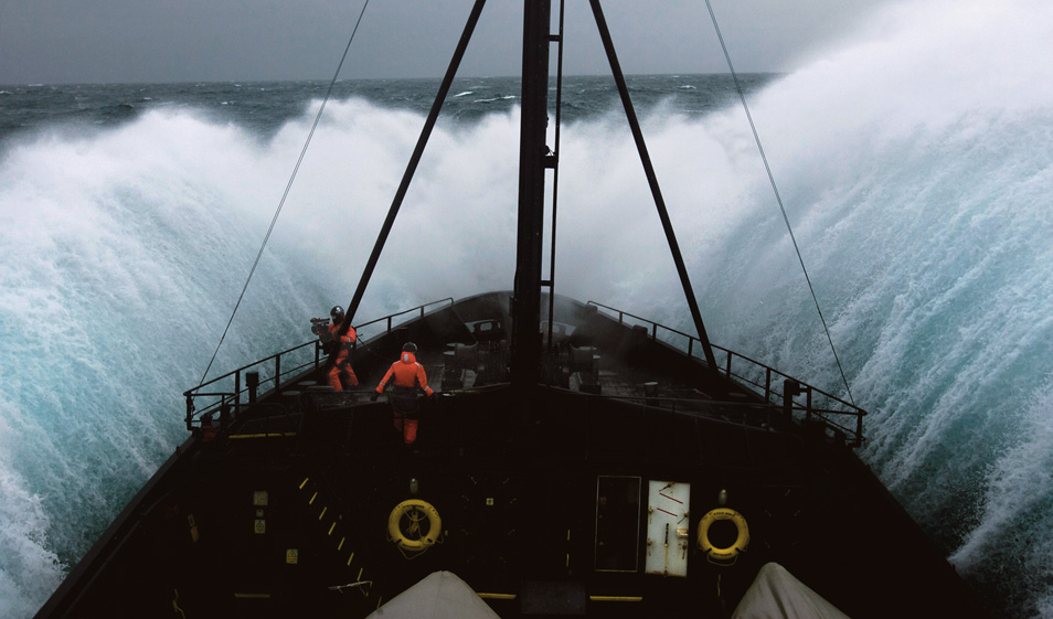 The crew brace themselves on the bow of the Sea Shepherd ship, MV Steve Irwin, as it plunges through Antarctic swells.