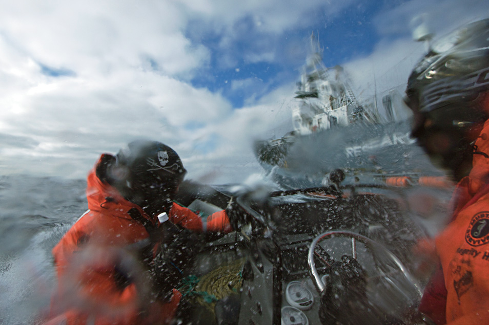 MV Steve Irwin crew in an inflatable fast boat, armed with bottles of rotten butter, are doused by water cannons from Japanese harpoon ship, the Yūshin Maru No. 1.