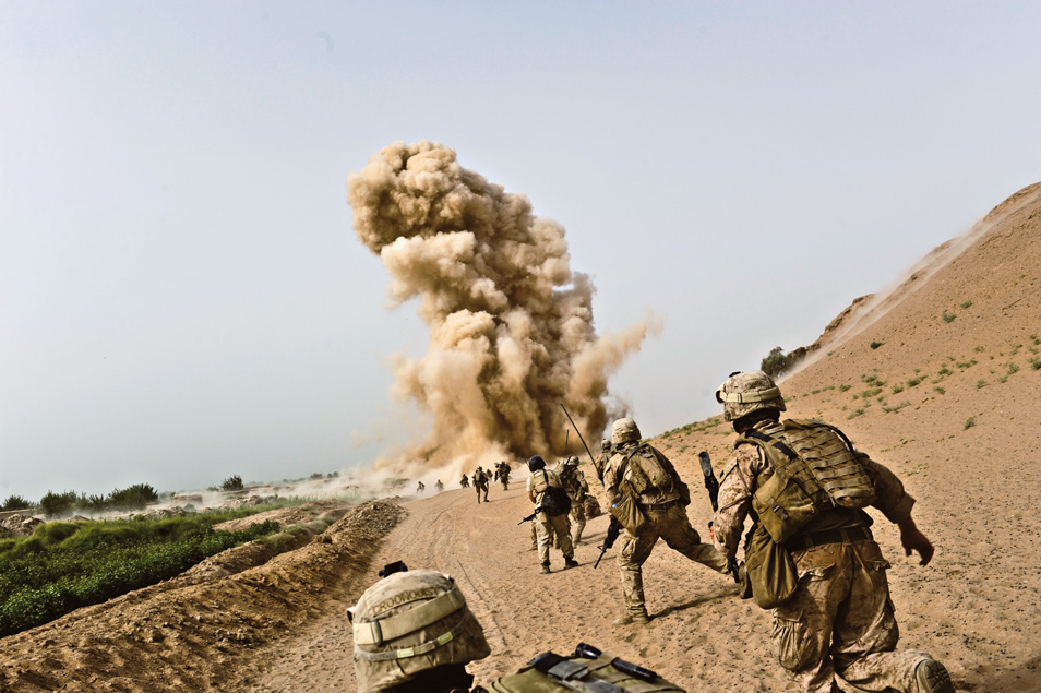 A hidden bomb explodes as Marines are on patrol. Had the bomber waited another few seconds, the patrol would have been right on top of the explosive. Instead, nobody was seriously hurt.