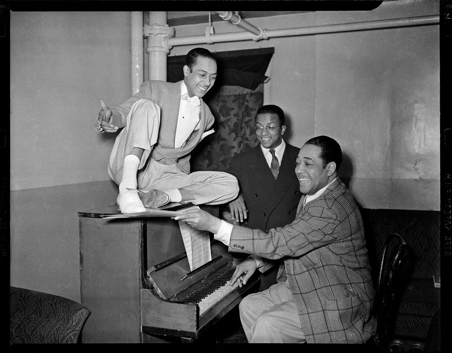 """""""Duke Ellington at piano, with dancer Honey Coles and Billy Strayhorn looking on, in the Stanley Theatre"""" by Teenie Harris © 2006 Carnegie Museum of Art, Pittsburgh"""