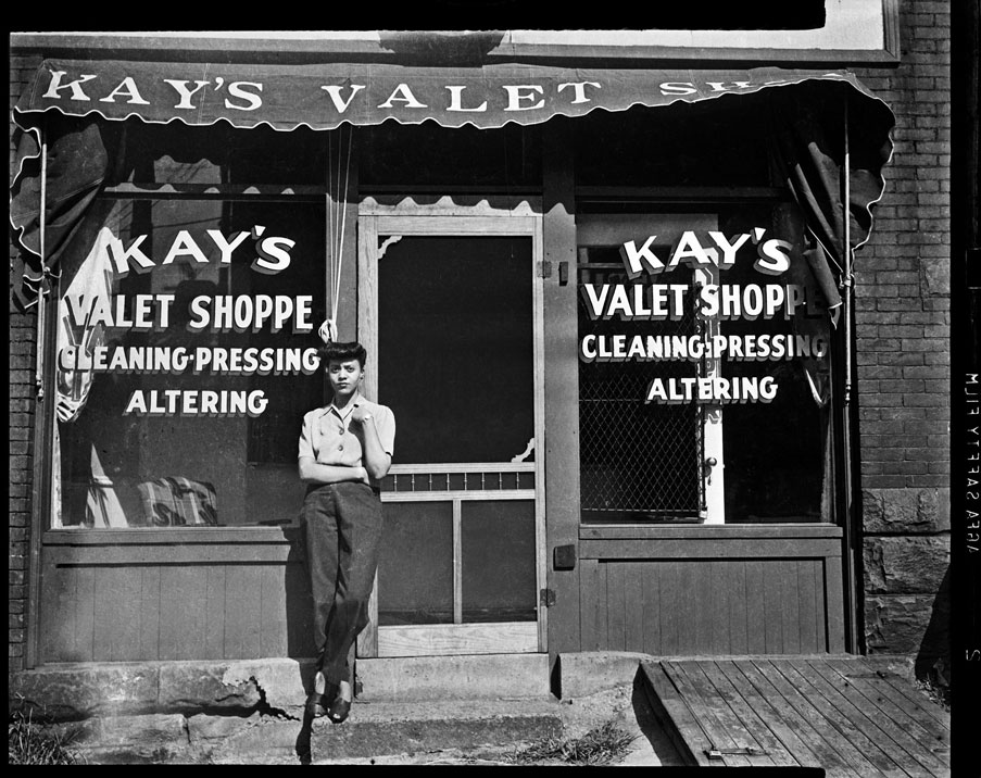 """Woman outside Kay's Valet Shoppe"" by Teenie Harris © 2006 Carnegie Museum of Art, Pittsburgh"