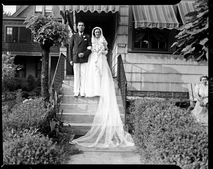 """""""Roland M. Sawyer and Aileen Eckstein Sawyer posed on their wedding day on steps of The Thimble Shop, 5913 Bryant Street, Highland Park"""" by Teenie Harris © 2006 Carnegie Museum of Art,"""