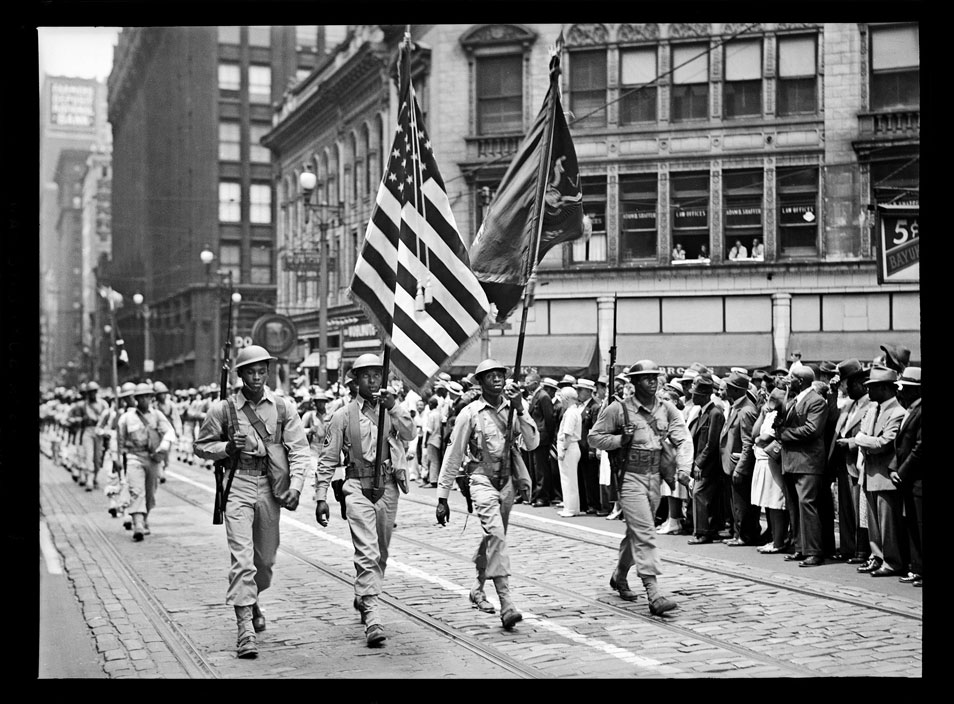 """""""Soldiers from the 372nd Infantry marching in parade, Fifth Avenue, Downtown"""" by Teenie Harris © 2006 Carnegie Museum of Art, Pittsburgh"""