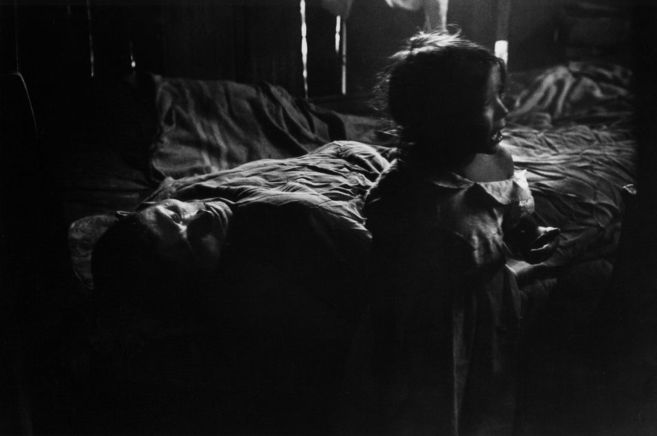 Isabel Beside Sick Father by Gordon Parks