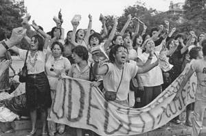Women soaked by water cannon during a demonstration against Pinochet on International Women's Day. Santiago, Chile, 1985. © Julio Etchart