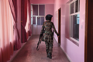 A lieutenant in the elite female counterterrorism unit patrols the women's barracks. © Stephanie Sinclair