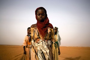 Young girls leave a camp for internally displaced persons (IDP) to gather firewood in Darfur. © Ron Haviv/VII, Courtesy of Anastasia Photo