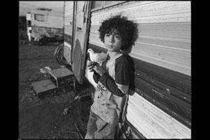 Child clown with his bird, roadside near Oaxaca, Mexico, 2010. © Mary Ellen Mark/Courtesy University of Texas Press
